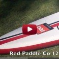 A close look at the red paddle inflatable racing SUP board