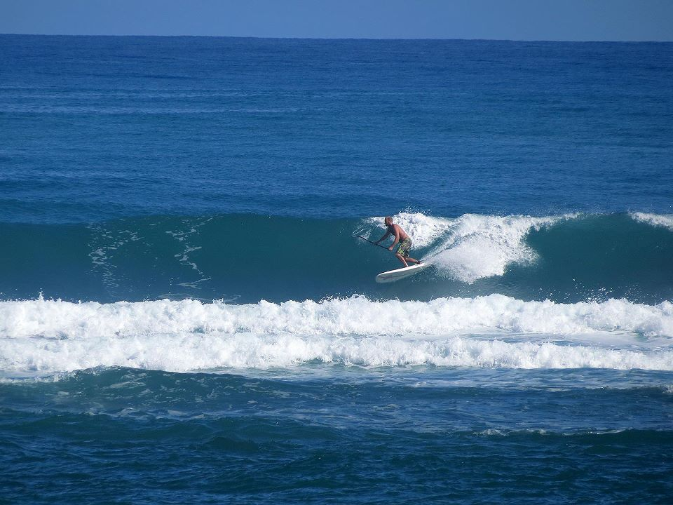 stand up paddling boarding in waves