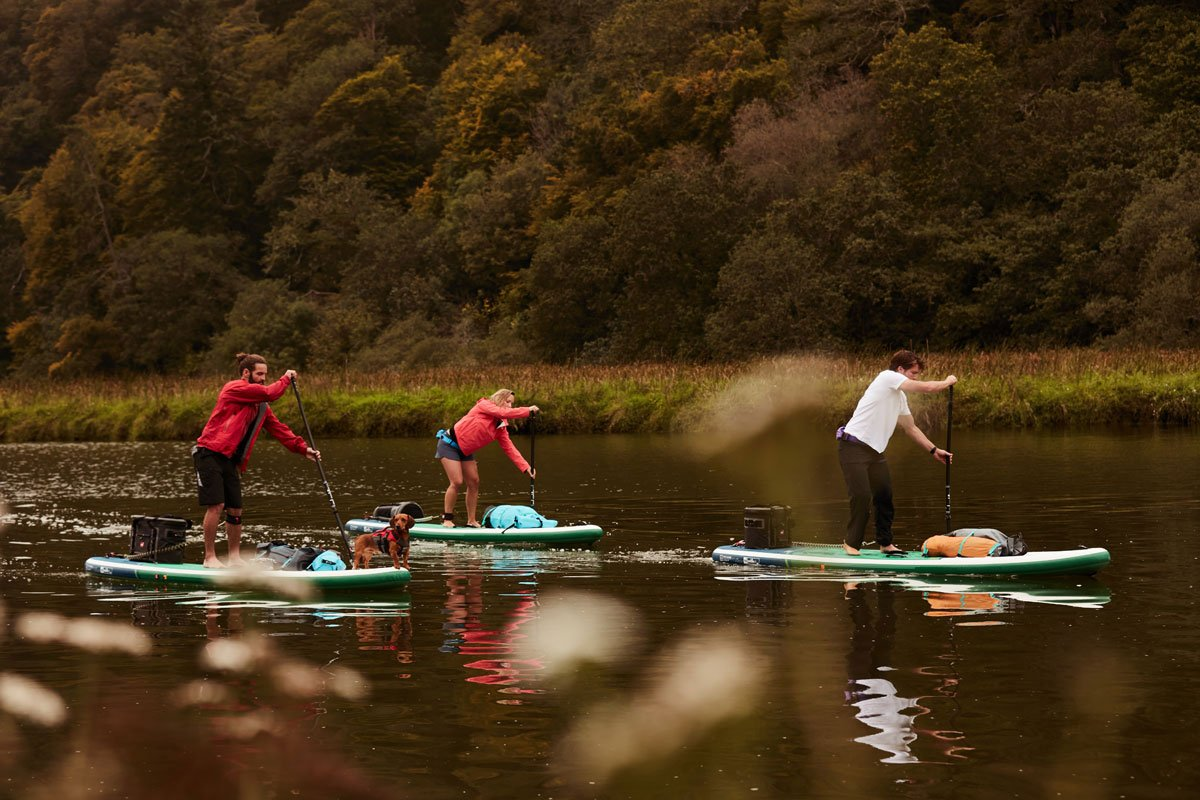 stand up paddling in fall with family and friends